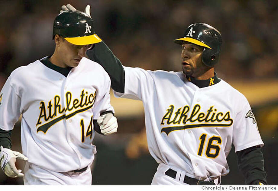 Mark Ellis (left) and Jay Payton score in the 4th inning. Oakland Athletics vs Chicago White Sox at McAfee Coliseum in Oakland on 9/15/06.  (Deanne Fitzmaurice/ The Chronicle) Photo: Deanne Fitzmaurice