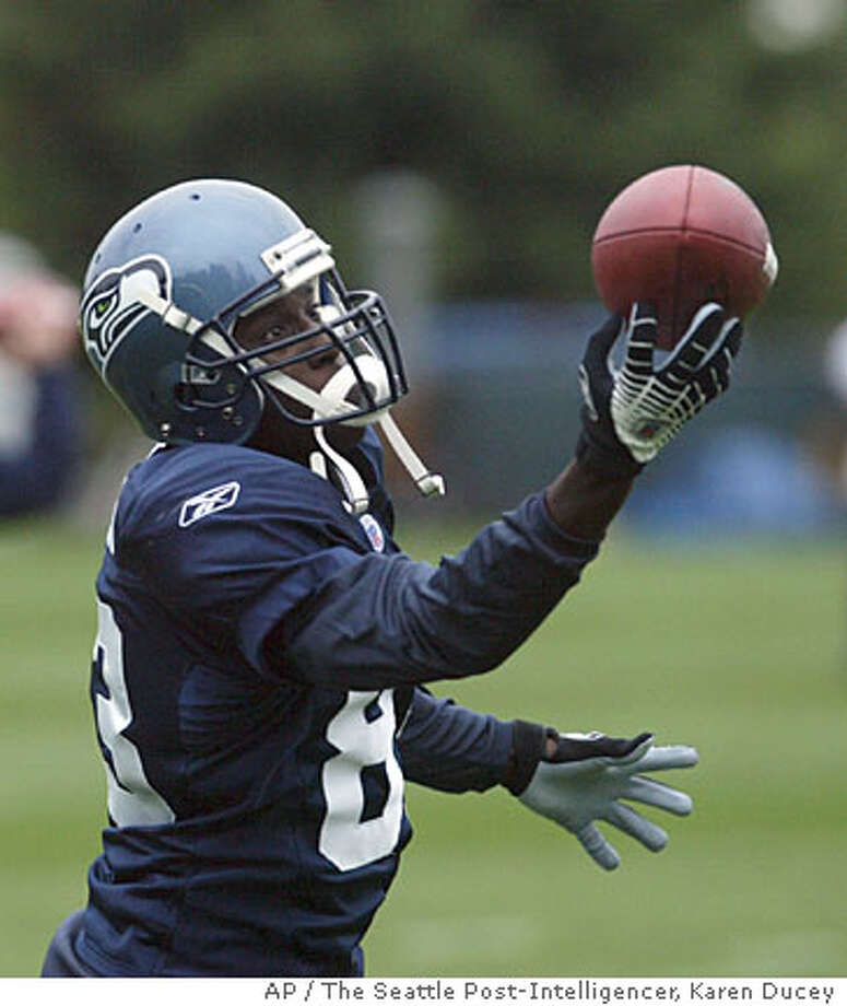 New Seattle Seawawk Deion Branch makes a one-handed catch during practice in Kirkland, Wash., Wednesday, Sept. 13, 2006. Seahawks coach Mike Holmgren began Wednesday telling his Seattle radio show that Branch would likely be on the sidelines Sunday against Arizona. But by afternoon--after watching Branch in a light, morning workout--Holmgren wavered. (AP Photo/The Seattle Post-Intelligencer, Karen Ducey) ** MAGS OUT, , NO ONLINE ** Photo: KAREN DUCEY