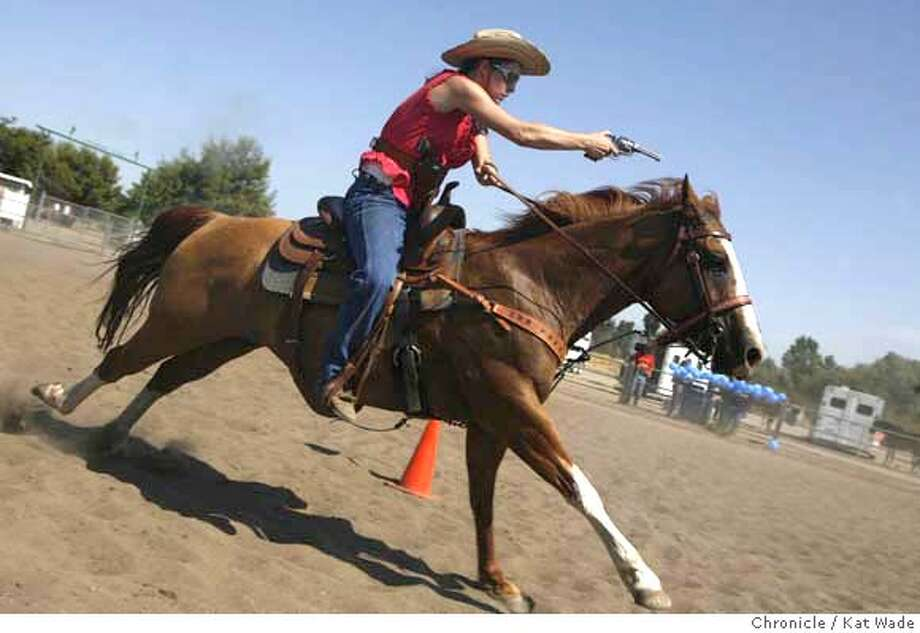 WADEwildwest_046_KW_.jpg STAND ALONE: (L to R) Mindy Mosteiro, of Stockton, alias Mae Dalton, the 2005 Cowboy Mounted Shooting Association Ladies 3 World Champion on her horse Cassey uses blanks that travel 18 feet to shoot balloon targets during rehearsal Sunday July 23, 2006 at The Robertson Community Park in Livermore Valley in Livermore. The California Range Riders Cowboy Mounted Shooting Association will be holding another practice on Sunday Aug. 27th for an upcoming competition Sept. 23 & 24th in Ceres Calif. The pracitce Aug. 27th will also be at the show arena at Robertson park and is open free of charge to the public. For more informtion regardign the California Range Riders you can visit their website at californiarangeriders.com.  Kat Wade/The Chronicle **Mindy Mosteiro alias Mae Dalton (Subjects) cq Mandatory Credit for San Francisco Chronicle and photographer, Kat Wade, Mags out Photo: Kat Wade