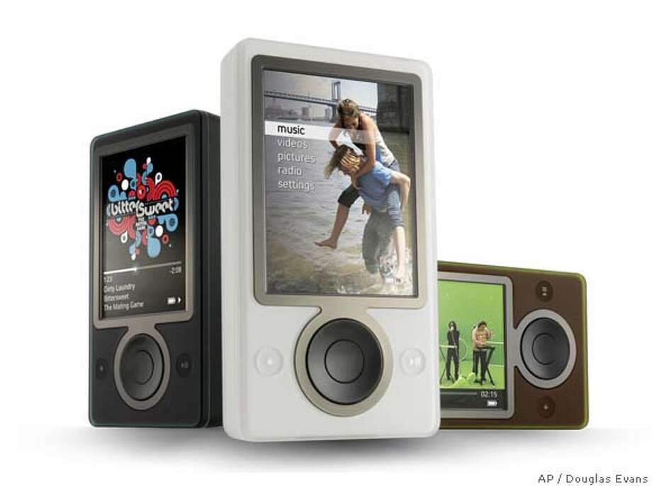 "In this photo provided by Microsoft on Thursday, Sept. 14, 2006, the new ""Zune"" portable media player is shown in black, white, and brown. The device represents Microsoft Corp.'s effort to compete against Apple's iPod will include wireless technology to let people share their favorite songs, playlists or pictures with other Zune users. Microsoft is headquartered in Redmond, Wash. (AP Photo/Courtesy Microsoft, Douglas Evans) HANDOUT PHOTO, Photo: DOUGLAS EVANS"