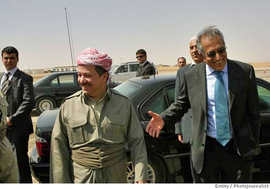 U.S. Ambassador to Iraq Zalmay Khalilzad, right, gestures as the president of Iraq's autonomous northern Kurdish region, Massoud Barzani, second left, looks on during a visit to the site of a new airport in Irbil, a city in the Kurdish controlled north, 350 kilometers (217 miles) north of Baghdad, Iraq, Wednesday Sept. 13, 2006. Barzani Wednesday said that once the central government approves a new flag for the country, he'll be proud to fly it. (AP Photo/Khalid Mohammed) PHOTO MADE AVAILABLE THURSDAY SEPT. 14, 2006 Photo: KHALID MOHAMMED