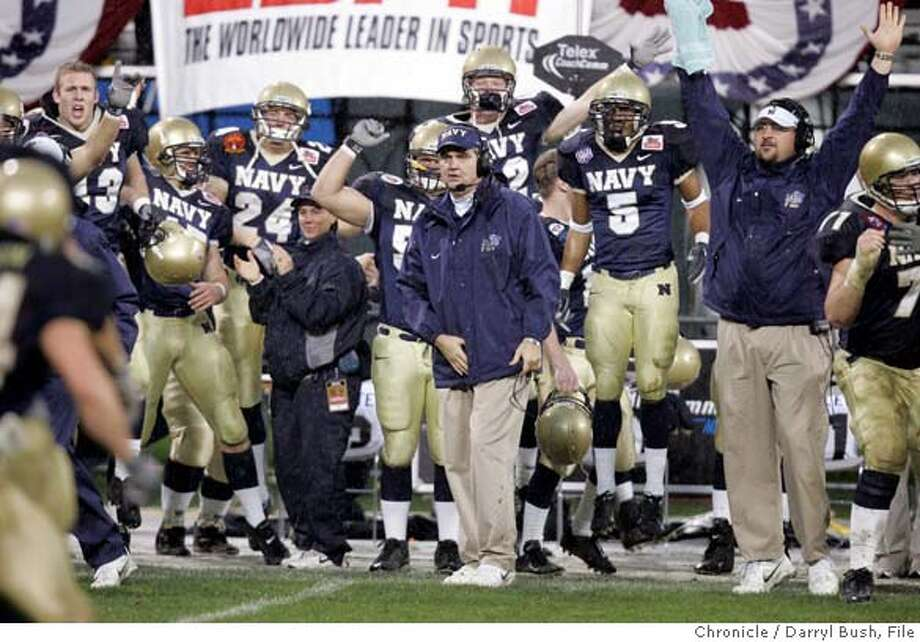 emeraldbowl_454_db.jpg  Navy's head coach Paul Johnson center watches from the sidelines as the Midshipmen ice the game late in the 4th qtr. vs. New Mexico in the Emerald Bowl at SBC Park. 12/30/04 in San Francisco Darryl Bush/The Chronicle MANDATORY CREDIT FOR PHOTOG AND SF CHRONICLE/ -MAGS OUT Photo: Darryl Bush