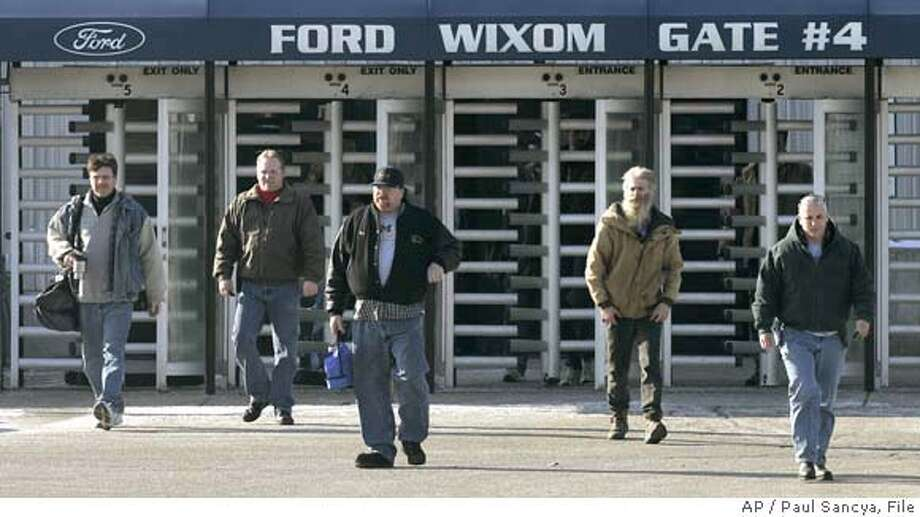 **FILE** Employees leave the Wixom Assembly Plant in a Wixom, Mich. file photo Jan. 23, 2006. Ford Motor Co. and the United Auto Workers have reached an agreement to offer buyout packages to more than 75,000 UAW workers, a local union official said Thursday, Sept. 14, 2006. (AP Photo/Paul Sancya, File) JAN. 23, 2006 FILE PHOTO Photo: PAUL SANCYA