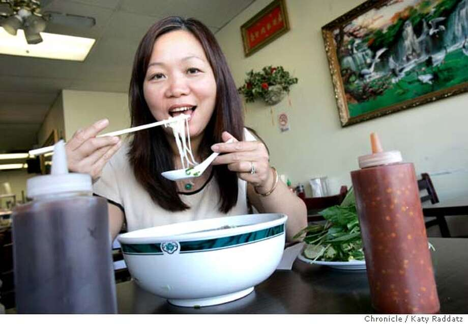 BARGAIN14_PHOHOAHUNG_017_RAD.jpg  SHOWN: Owner Rose Nguyen enjoys a big bowl of Dac Biet Special Combo: rare steak, well done brisket, flank, tendon, and tripe noodle soup. Pho Hoa Hung is a tiny, wonderful Vietnamese noodle house at 2211 international Blvd. in Oakland. These photos shot in Oakland, CA. on Monday, Sept. 11, 2006.  (Katy Raddatz/The S.F.Chronicle)  **Rose Nguyen, Dac Biet  Ran on: 09-14-2006  Owner Rose Nguyen enjoys the Dac Biet Special Combo, a hearty blend of meats and noodles, at Pho Hoa Hung in Oakland. Photo: Katy Raddatz