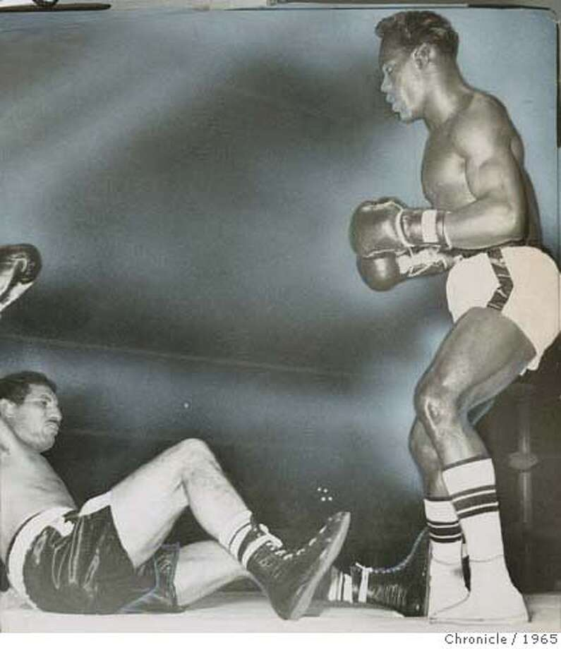 Jimmy Lester knocks down Florentino Fernandez at Kezar Pavillion, 10/20/1965 MANDATORY CREDIT FOR PHOTOG AND SF CHRONICLE/ -MAGS OUT
