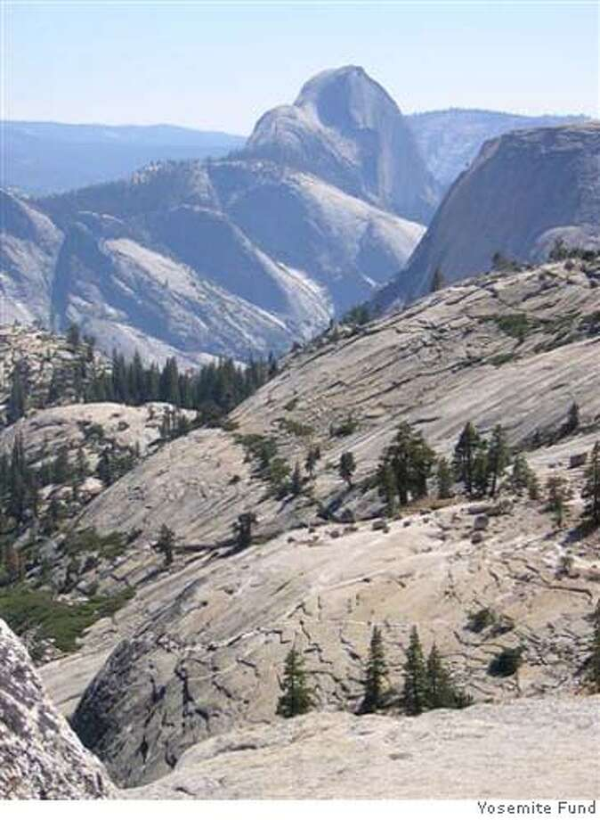 OVERLOOK01_PH2.JPG View of Half Dome fr Olmsted Point by The Yosemite Fund. handout/ handout Ran on: 10-01-2005  From Olmstead Point, visitors to Yosemite National Park can look west to the back side of Half Dome. Photo: Handout
