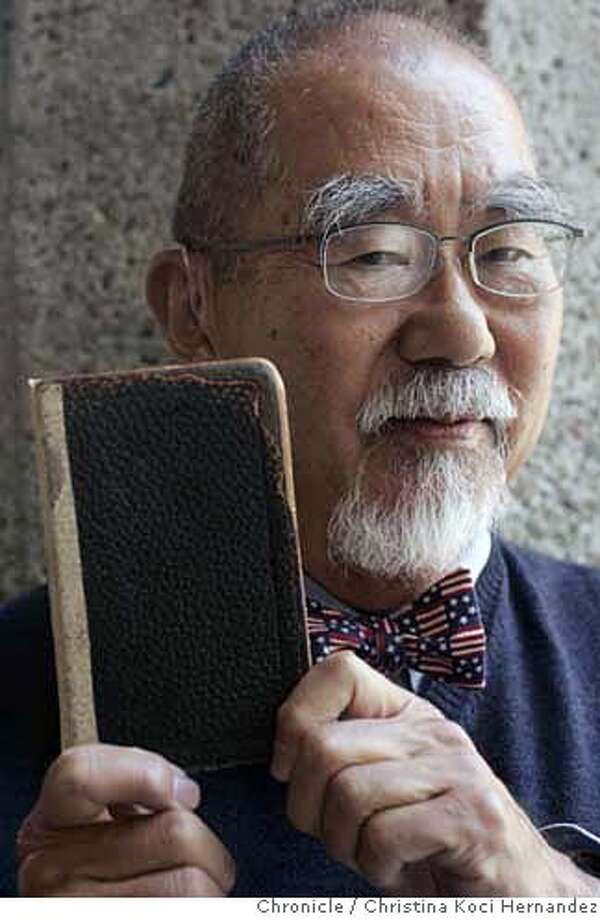 "Donald Nakahata holds his grandfather's marriage ledger.The grandfather was a pastor in SF who performed many weddings for the Japanese women who went through Angel Island when they came to America under arranged marriages (they're sometimes called ""picture brides""). (CHRISTINA KOCI HERNANDEZ/THE CHRONICLE) Mandatory Credit For Photographer and San Francisco Chronicle/No-Sales-Mags Out Photo: Christina Koci Hernandez"