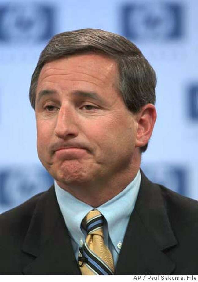 """** FILE ** Hewlett-Packard Co. chief executive Mark Hurd listens to a question during a news conference at HP headquarters in Palo Alto, Calif., Wednesday, March 30, 2005. Computer maker Hewlett-Packard Co. on Tuesday, July 19, 2005, said it will cut 14,500 jobs, about 10 percent of its full-time staff, as part of a restructuring plan designed to save $1.9 billion annually and boost business performance. """"After a thorough review of our business, we have formulated a plan that will enable HP to begin delivering its full potential,"""" Hurd said in a statement Tuesday. (AP Photo/Paul Sakuma, file) Ran on: 07-20-2005  Mark Hurd, HP's CEO, conducts a news conference at company headquarters in March. MARCH 30 2005 FILE PHOTO Photo: PAUL SAKUMA"""