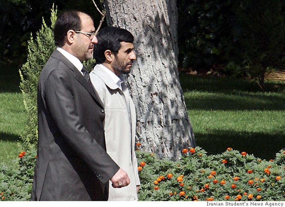 Iranian President Mahmoud Ahmadinejad, right, and Iraqi Prime Minister Nouri Al-Maliki, attend an official welcoming ceremony for Al-Maliki, in Tehran, Iran, Tuesday, Sept. 12, 2006. Iraq's prime minister received a red-carpet welcome at the Iran's presidential palace on Tuesday at the start of his first official visit to the Shiite Muslim country since taking office in May.(AP Photo,ISNA)