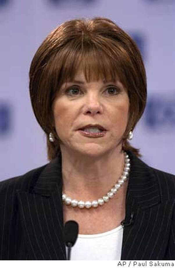 ** FILE ** Hewlett-Packard Company's Patricia Dunn speaks during a news conference at HP headquarters in a Palo Alto, Calif. file photo from March 30, 2005. Federal investigators stepped into the fray surrounding Hewlett-Packard Co.'s possibly illegal investigation of media leaks, as the company's board planned to meet again to discuss the fate of embattled Dunn. (AP Photo/Paul Sakuma, File) MARCH 30, 2005 FILE PHOTO Photo: PAUL SAKUMA