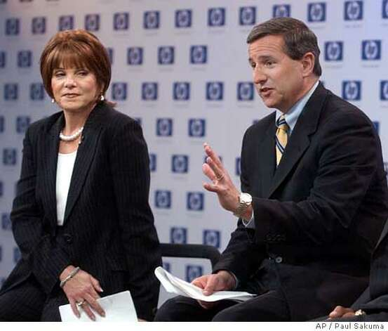 Hewlett-Packard Co. new president and CEO Mark Hurd, center, gestures as he sits next to Patricia Dunn, left, HP's non-executive chairman, during a news conference at HP headquarters in Palo Alto, Calif., Wednesday, March 30, 2005. Investigators hired by Hewlett Packard Co. to plug a leak on the company's board duped phone companies to obtain the records of at least nine reporters, further convincing California authorities that the state's privacy laws were broken. (AP Photo/Paul Sakuma) Photo: PAUL SAKUMA