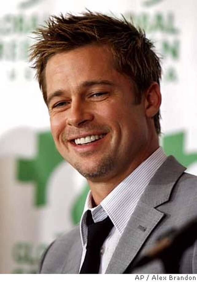 **FILE**Actor Brad Pitt smiles during a news conference in New Orleans on Aug. 31, 2006. Pitt says he won't be marrying Angelina Jolie until the restrictions on who can marry whom are dropped. The 42-year-old actor reveals his plans for marriage in Esquire magazine's October issue, on newsstands Sept. 19,2006. (AP Photo/Alex Brandon) AN AUG 31 2006 FILE PHOTO Photo: ALEX BRANDON