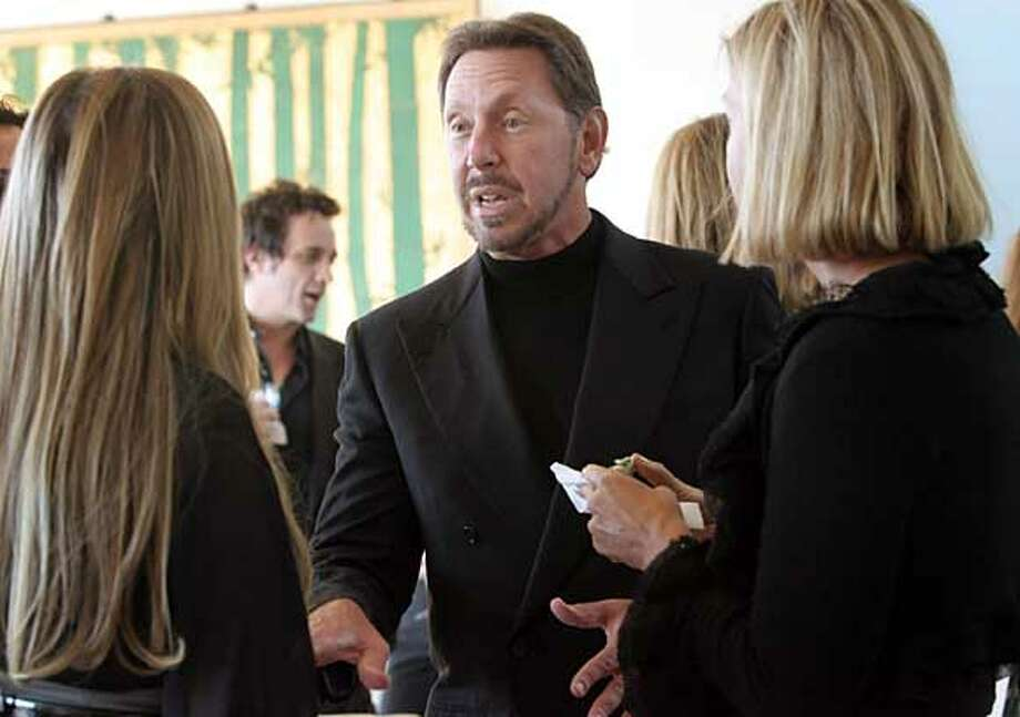 HUFFINGTON  Larry Ellison talk with guests at his Party to celebrate the new book On Becoming Fearless by Arianna Huffington at his Pacific Heights home. Event on 9/12/06 in San Francisco.  Penni Gladstone / The Chronicle  Ran on: 09-13-2006  Larry Ellison talks with guests at his party in Pacific Heights to celebrate the new book by Arianna Huffington. Photo: Penni Gladstone