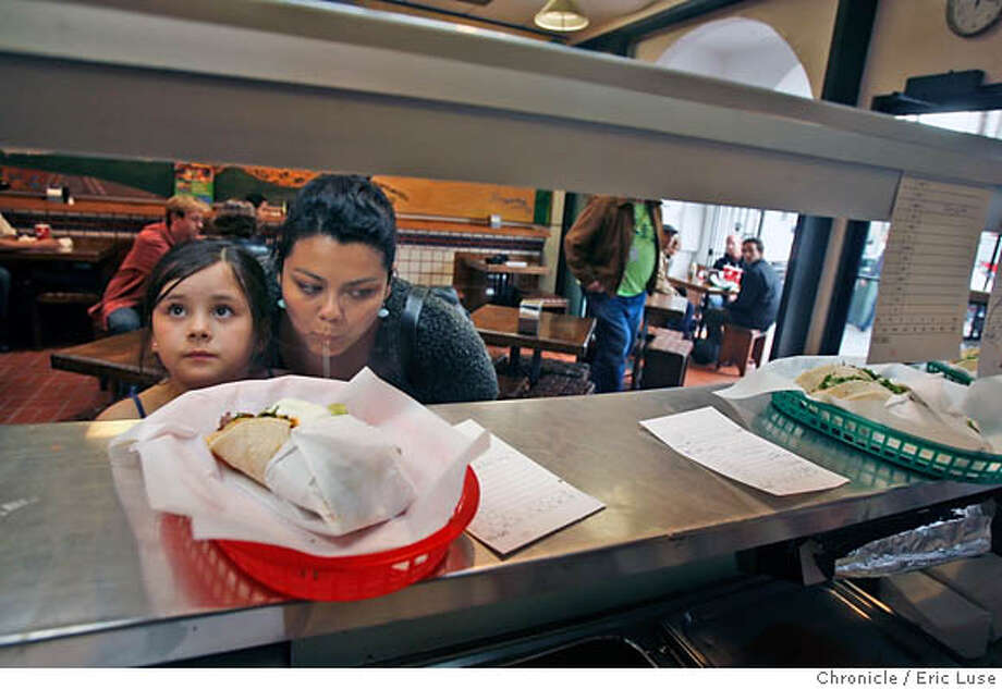taqueria13_lataqueria_475_el.jpg  Katya Stich,7, and her mom Alejandna , SF waiting for their order to come up.  La Taqueria 2889 Mission St.  They don't believe in using rice in their burritos. Eric Luse/The Chronicle Names (cq) from source MANDATORY CREDIT FOR PHOTOG / Photo: Eric Luse