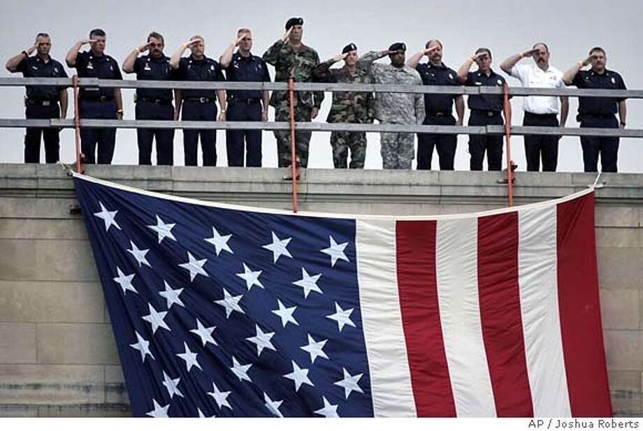 First responders to the Pentagon salute during the fifth anniversary ceremony marking the Sept. 11th terrorist attacks at the Pentagon in Washington Monday, Sept. 11, 2006. (AP Photo/Joshua Roberts, Pool) 0 Photo: JOSHUA ROBERTS