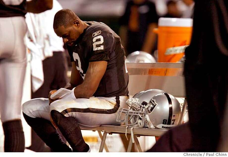 Oakland QB Aaron Brooks sits on the sidelines in the 2nd quarter.  Oakland Raiders play the San Diego Chargers at McAfee Coliseum on Sept. 11, 2006.  Paul Chinn /The Chronicle Photo: Paul Chinn