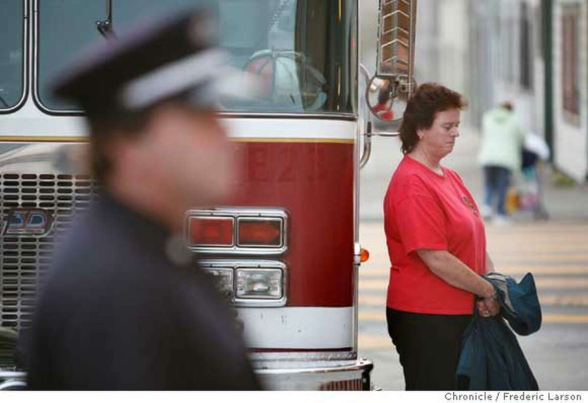 Susan Moorehead who was from New York City came to Station 7 at 19th and Folsom to pay her repects to the fallen firefighters who where killed in 9/11 attacks 5-years-agoi. City wide at all 42 stations, beginning at 6:45 a.m. and ending at 7:02 a.m the fallen will be honored. ***Susan Moorehead 9/11/06 {Frederic Larson/The Chronicle }
