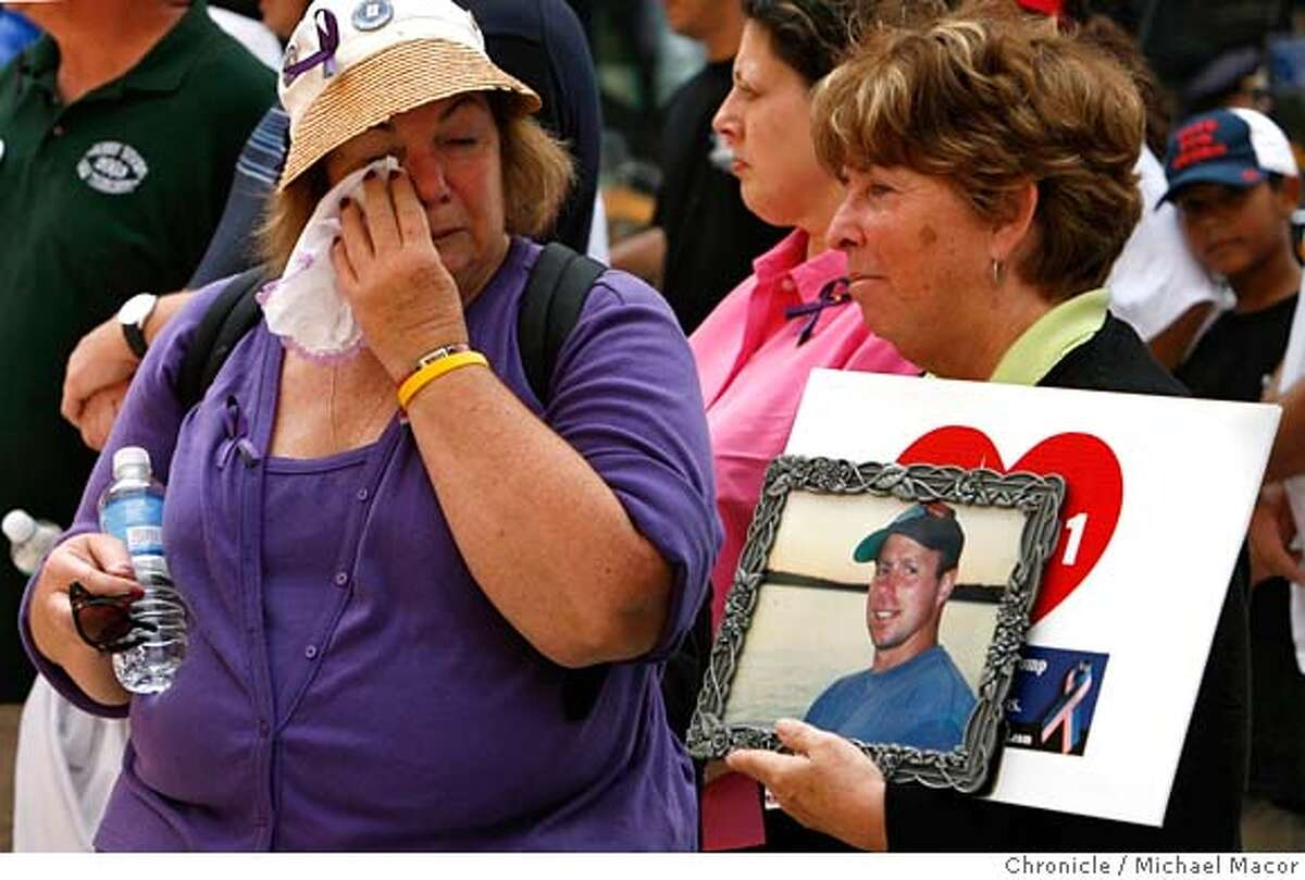 Maureen Bosco holds a photo of her son Richard, lost in the 9/11 attacks. Barbara Heimlich wipes away tears, Robert is her son-in-laws brother. At the end of the Tribute Walk, the group stops in front of Ground Zero to support WTC Families For A Proper Burial. The group wants the remains of loved ones, given a proper and dignified burial, they believe are with the debris removed from Ground Zero and now at the Fresh Kills Landfill on Staten Island. They are suing New York authorities for the right to a proper burial. A small group of survivors, families and friends gathered today to travel on a walk near Ground Zero and thanks those who helped during the 9/11 attacks as well as stop and remember those lost that day. Stops at the Midtown NYPD, House 10 of the FDNY, St. Paul's church, and survivors staircase at Ground Zero.The Walk of Tribute. A visit to New York City as it prepares for the 5 year anniversary of the 9/11 attacks on the World Trade Center. Event in, New York, NY, on 9/9/06. Photo by: Michael Macor/ San Francisco Chronicle
