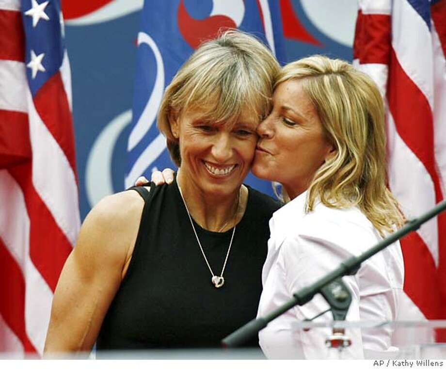Martina Navratilova, left, is hugged by Chris Evert before the men's final at the US Open tennis tournament in New York, Sunday, Sept. 10, 2006.(AP Photo/Kathy Willens) Photo: KATHY WILLENS