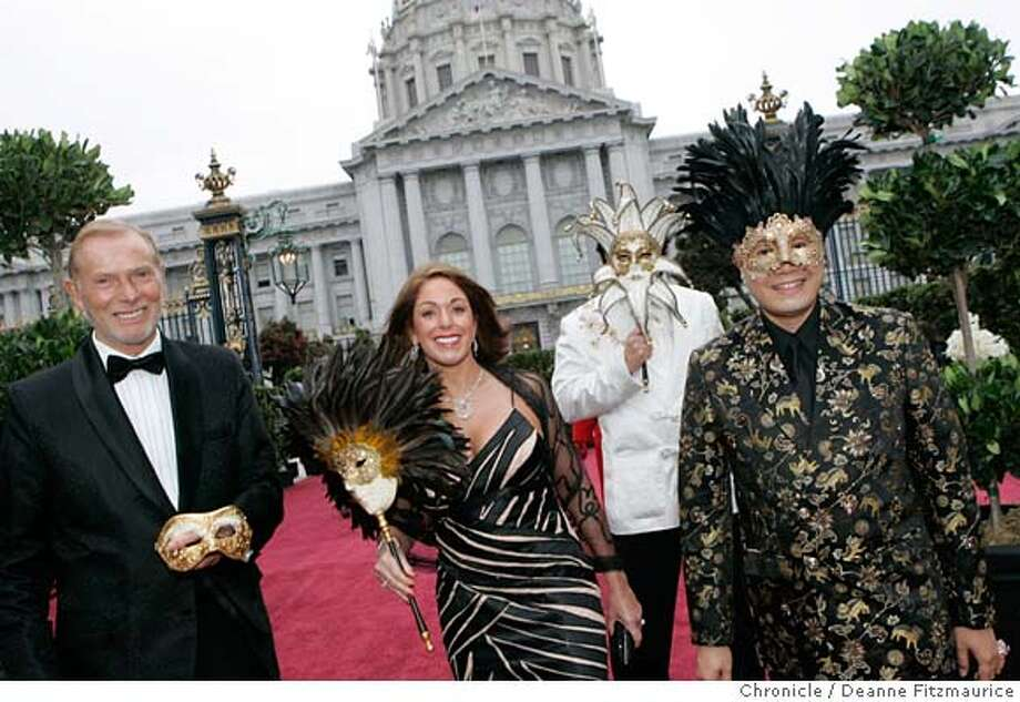 opera_0058_df.jpg  Arriving for the party before the Opera are: at right fashion designer Max Nugus who designed the outfits and masks for himself and his three friends, starting from left, George Sanbrook, Mary Sanbrook and Rafe Guerra. Opening of the San Francisco Opera season. Photographed in San Francisco on 9/8/06.  (Deanne Fitzmaurice/ The Chronicle) Mandatory credit for photographer and San Francisco Chronicle. /Magazines out. Photo: Deanne Fitzmaurice