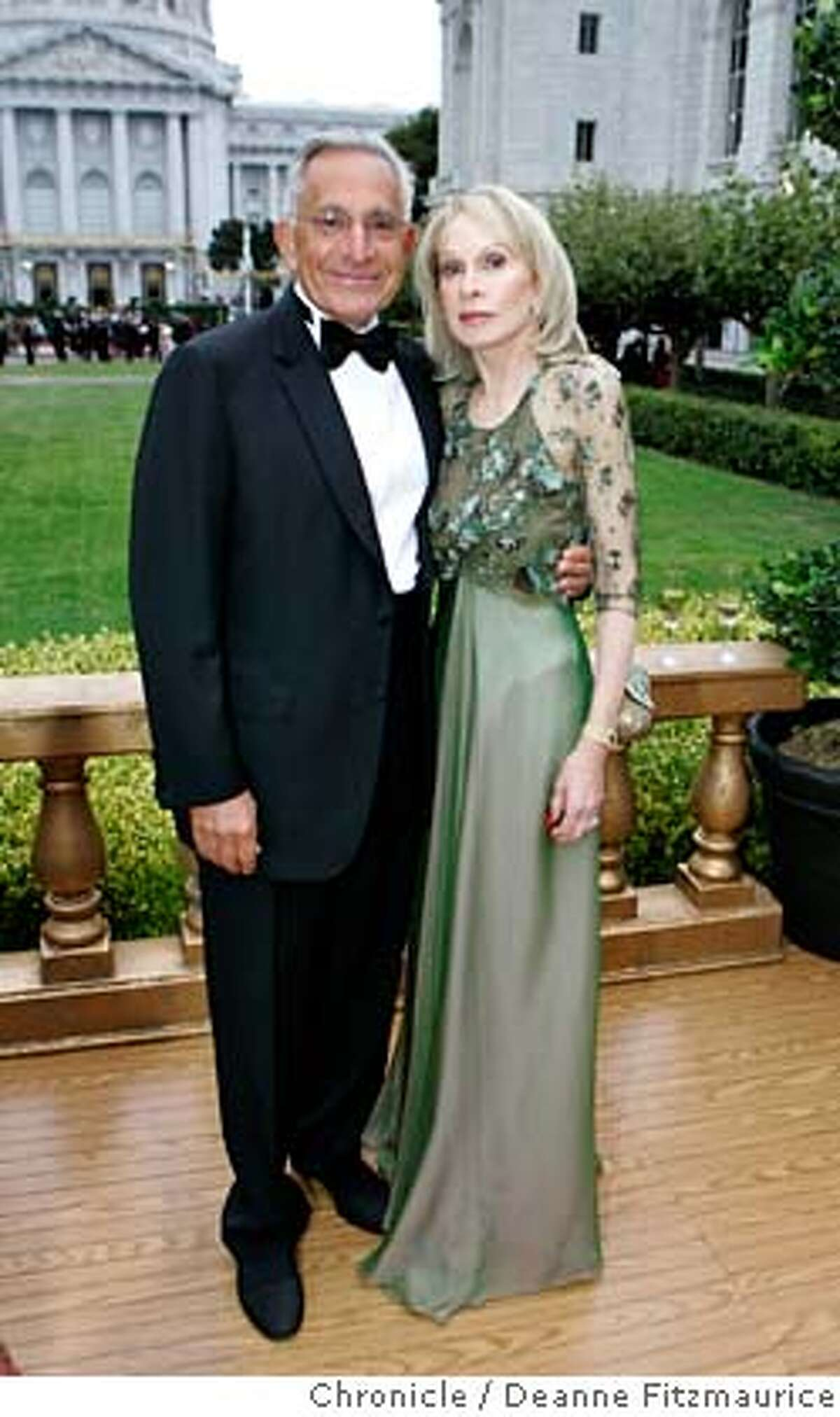 opera_0006_df.jpg Gala chairwoman Judith Renard and her husband, John, pose as they arrive for the party before the Opera. Judith is wearing a moss green peau de soie silk and iridescent silk chiffon gown by Bill Blass. Opening of the San Francisco Opera season. Photographed in San Francisco on 9/8/06. (Deanne Fitzmaurice/ The Chronicle) Mandatory credit for photographer and San Francisco Chronicle. /Magazines out.