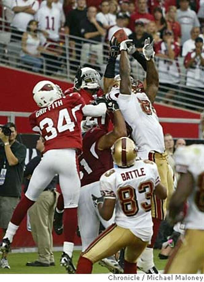 49ers Vernon Davis (#85) goes up for a hail mary pass and does not make the catch. Cardinals Robert Griffith (#34), SF #83 Arnaz Battle  San Francisco 49ers vs Arizona Cardinals at the new Cardinals Stadium.  Photo by Michael Maloney / San Francisco Chronicle on 9/10/06 in Glendale,AZ Photo: Michael Maloney