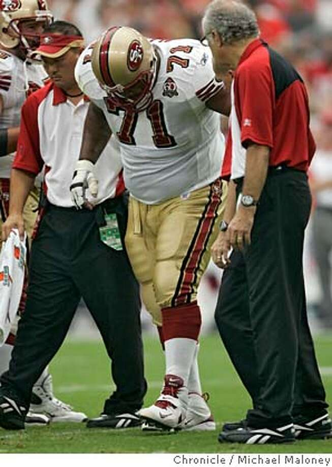 49ers Larry Allen (#71) is taken off the field with a 1st qtr injury.  San Francisco 49ers vs Arizona Cardinals at the new Cardinals Stadium in Glendale, Arizona.  Photo by Michael Maloney / San Francisco Chronicle on 9/10/06 in Glendale,AZ Photo: Michael Maloney