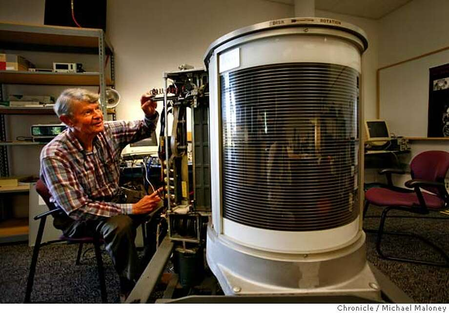Al Hoagland tinkers with the hard drive he helped develop 50 years ago at IBM. The 600 lb hard drive called the RAMAC contains 50 - 24 inch discs that spin up to 1200 rpm. RAMAC stands for Random Access Method of Accounting and Control.  Hoagland is one of the people who worked on the team that developed the first hard drive for IBM 50 years ago this month. He's got the RAMAC back and is gearing it up to work again at the Computer History Museum in Mountain View. Photo by Michael Maloney / San Francisco Chronicle on 9/5/06 in MOUNTAIN VIEW,CA  ***Al Hoagland MANDATORY CREDIT FOR PHOTOG AND SF CHRONICLE/ -MAGS OUT Photo: Michael Maloney