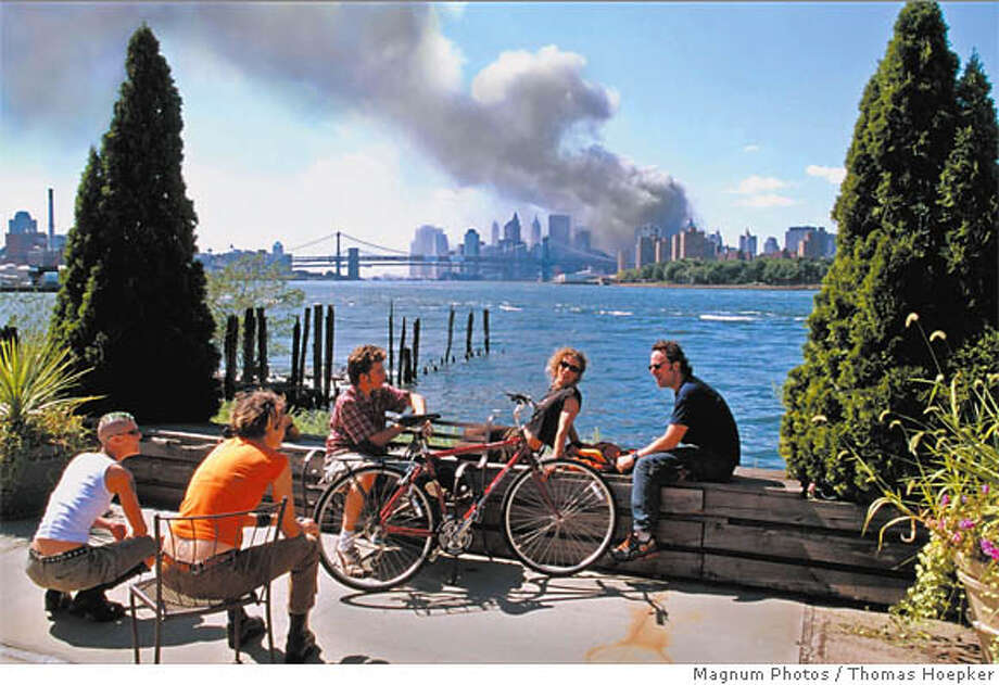 This photo was shot on 9/11 in Brooklyn, but the photographer found it so upsettingly tranquil he didn't publish the image widely until four years after the attack. Magnum Photos image by Thomas Hoepker