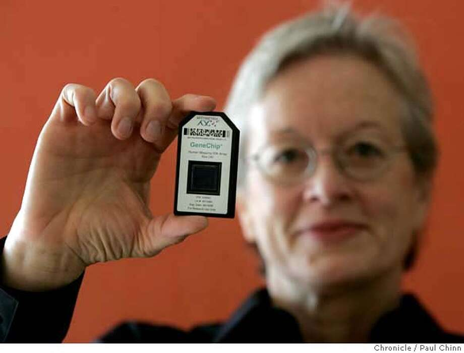 Dr. Janet Warrington, a vice president of Affymetrix, holds a DNA micro array chip in Santa Clara, Calif. on Friday, September 8, 2006. The biotechnology firm manufactures the GeneChip micro array which analyzes DNA composition. A study commissioned by the Food and Drug Administration has affirmed the accuracy and validity of the micro array which, until now, had been disputed. Warrington co-authored three of the articles included in the study. PAUL CHINN/The Chronicle  **Dr. Janet Warrington MANDATORY CREDIT FOR PHOTOGRAPHER AND S.F. CHRONICLE/ - MAGS OUT Photo: PAUL CHINN