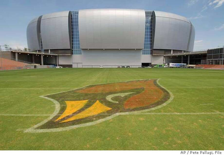 ** ADVANCE FOR WEEEKEND EDITIONS, AUG. 19-20 ** FILE ** The Arizona Cardinals' football field gets some sun Tuesday, Aug. 8, 2006, in preparation for the team's first game in the new stadium in Glendale, Ariz., a pre-season game against the Pittsburgh Steelers Saturday. (AP Photo/Daily News-Sun, Pete Pallagi) A AUG. 8, 2006 FILE PHOTO ** ADVANCE FOR WEEEKEND EDITIONS, AUG. 19-20 ** ARIZONA REPUBLIC OUT Photo: PETE PALLAGI