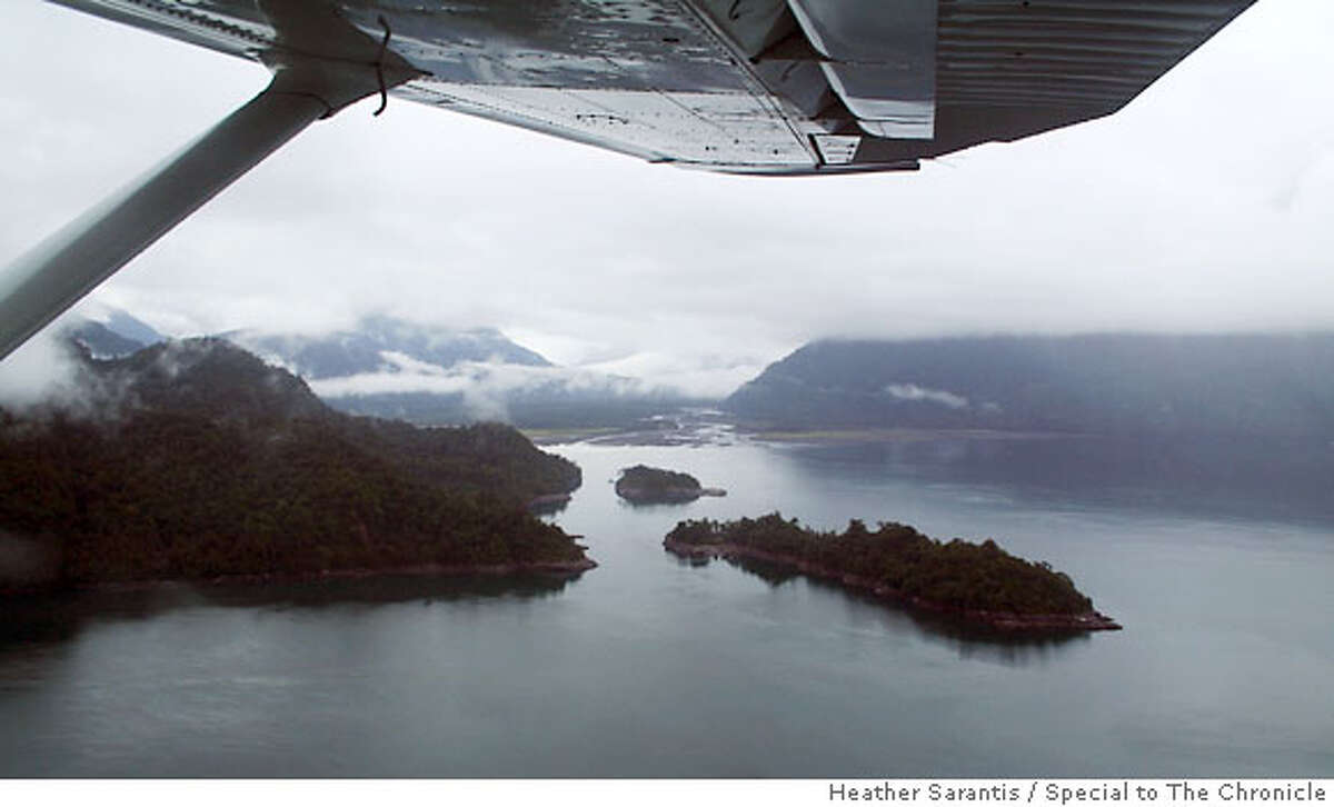 Renihue Fjord in Pumalin Park, as seen from the Tompkins� plane. Power lines from the proposed Endesa-HydroQuebec project, which the Tompkins are fighting, would cut directly through this scene. Photo by Heather Sarantis/Special to The Chronicle Ran on: 09-10-2006
