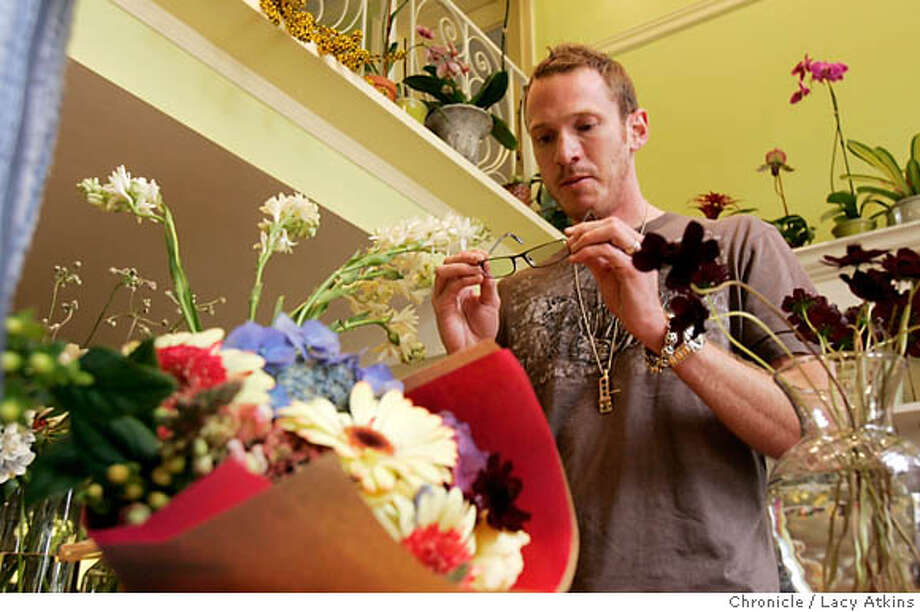"Bjorn Thuvesson checks out Michael Ritz glasses as he shops for a bouquet for his wife at the Church Street Flowers , Tuesday Aug. 15, 2006, in San Francisco, Ca. Bjorn Thuvesson, a Swedish native who owns"" bjorn"",eyewear stores in San Francisco. .Ca. (Lacy Atkins/The Chronicle) MANDATORY CREDITFOR PHOTGRAPHER AND SAN FRANCISCO CHRONICLE/ -MAGS OUT Photo: Lacy Atkins"