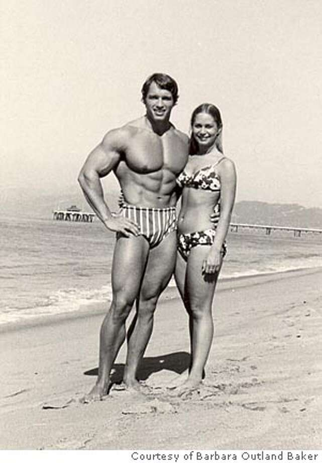 """Arnold Schwarzenegger (left) and Barbara Outland Baker in an undated photo which appears on the cover of Baker's book, """"Arnold and Me: In the Shadow of the Austrian Oak."""" PHOTO COURTESY BARBARA OUTLAND BAKER. Ran on: 09-10-2006  Gov. Arnold Schwarzenegger and Barbara Outland Baker in an undated photo that appears on the cover of Outland Baker's book, &quo;Arnold and Me: In the Shadow of the Austrian Oak.&quo;  Ran on: 09-10-2006  Gov. Arnold Schwarzenegger and Barbara Outland Baker in an undated photo that appears on the cover of Outland Baker's book, &quo;Arnold and Me: In the Shadow of the Austrian Oak.&quo;  Ran on: 09-10-2006 Photo: Ho"""