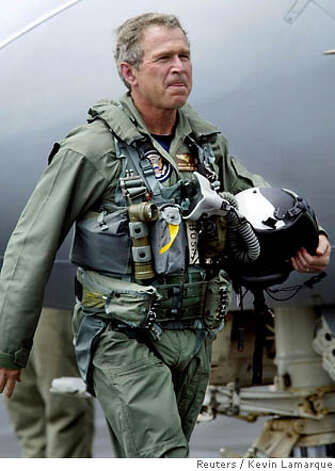President Bush makes a big splash on an aircraft carrier in May 2003 to announce the end of major combat operations in Iraq. Reuters file photo by Kevin Lamarque