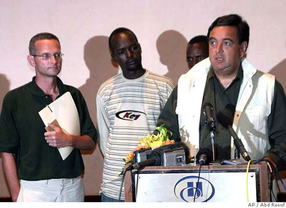 """Bill Richardson, the governor of the U.S. state of New Mexico, right, talks as the American journalist Paul Salopek, left, who was released Saturday from a prison in the war-torn Darfur region where he was held for more than a month on espionage charges, at a press conference in Khartoum, Sudan on Saturday, Sept. 9, 2006. The Chicago Tribune journalist, who was freed along with his Chadian driver and interpreter, said during a brief news conference in this Sudanese capital that his """"treatment was excellent."""" Salopek, 44, was on assignment for National Geographic magazine when he was arrested last month and accused of passing information illegally, writing """"false news"""" and entering the African country without a visa. Bill Richardson, the governor of the U.S. state of New Mexico, traveled to Sudan on Friday to meet with President Omar al-Bashir and persuaded him to release Salopek and his colleagues. (AP photo/Abd Raouf) Photo: ABD RAOUF"""