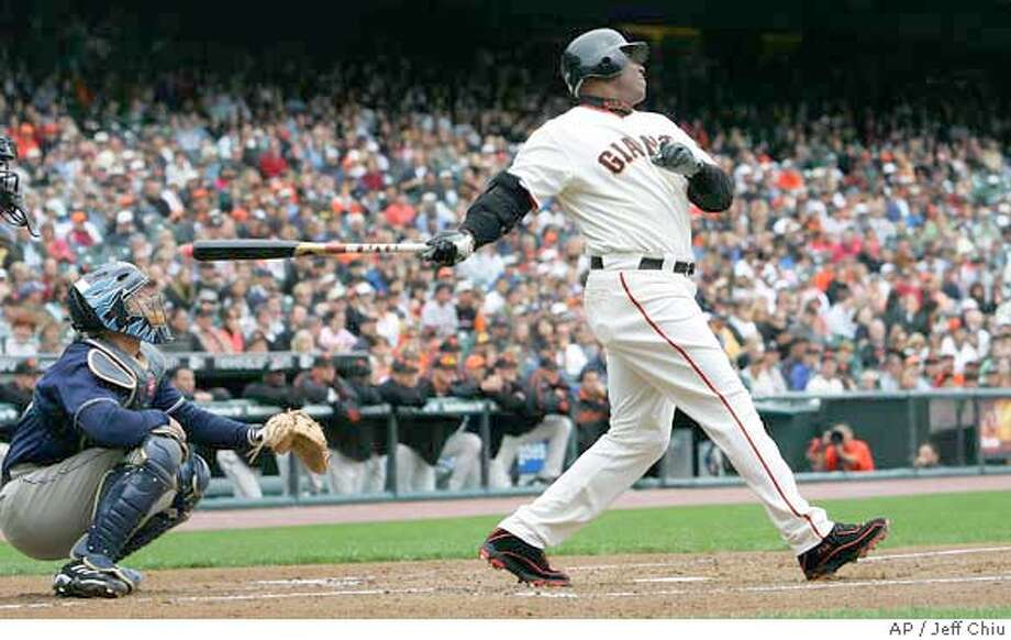 **CORRECTS DAY** San Francisco Giants' Barry Bonds, right, swings on his two-run home run off of San Diego Padres' David Wells to score Shea Hillenbrand in the first inning of their baseball game in San Francisco, Saturday, Sept. 9, 2006. It was Bonds' 731st career home run. At left is Padres' Josh Bard. (AP Photo/Jeff Chiu) Photo: JEFF CHIU