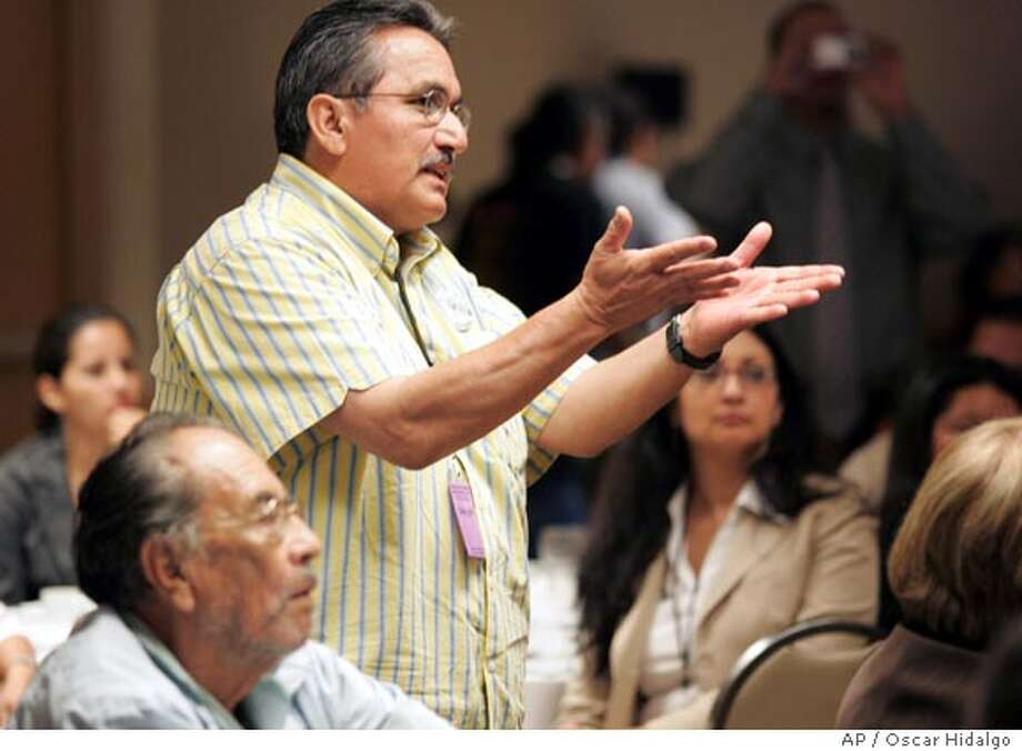 Roselio Munoz comments during a question and answer session during the four-day National Latino Congreso in Los Angeles, Wednesday, Sept. 6, 2006. The gathering of hundreds comes as the U.S. Congress returns for its fall session having all but shelved immigration reform after the issue dominated the national agenda earlier this year. (AP Photo/Oscar Hidalgo) Photo: OSCAR HIDALGO