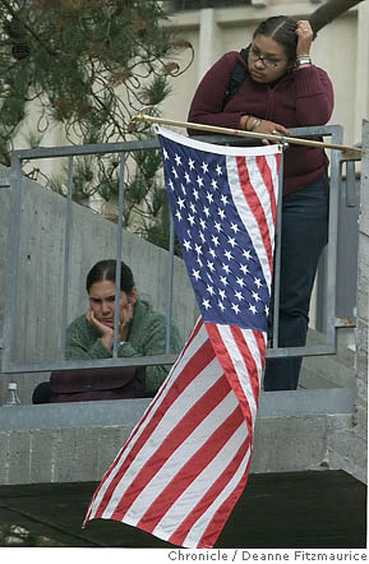 Naomi Gregory (left) and Elizabeth Solis listen to speakers at SFSU. Chronicle file photo, 2001, by Deanne Fitzmaurice