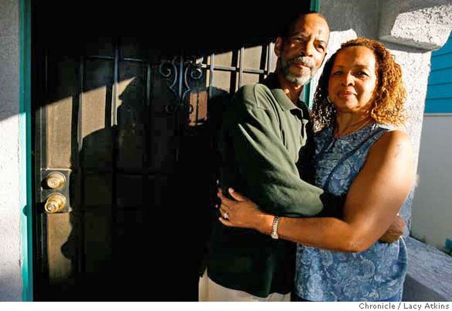 Brenda Johnson and her husband Lester at thier home in East Oakland, Wednesday Aug. 30, 2006, in Oakland, Ca. Brenda Johnson at her home in East Oakland, Wednesday Aug 30, 2006. Johnson, 55, has confronted dealers and drug addicts when they venture onto her street, politely asking them to move along. Johnson said a major problem is that the police are often overwhelmed and can take hours to respond to calls, something the thugs in the neighborhood know all too well.(Lacy Atkins/The Chronicle) Ran on: 09-10-2006  Terry Holmes and Wayne White, who have been neighbors on 64th Avenue for many years, talk about the positive and negative changes they have seen over time in the area of East Oakland where they live.  Ran on: 09-10-2006  Terry Holmes and Wayne White, who have been neighbors on 64th Avenue for many years, talk about the positive and negative changes they have seen over time in the area of East Oakland where they live. Photo: Lacy Atkins
