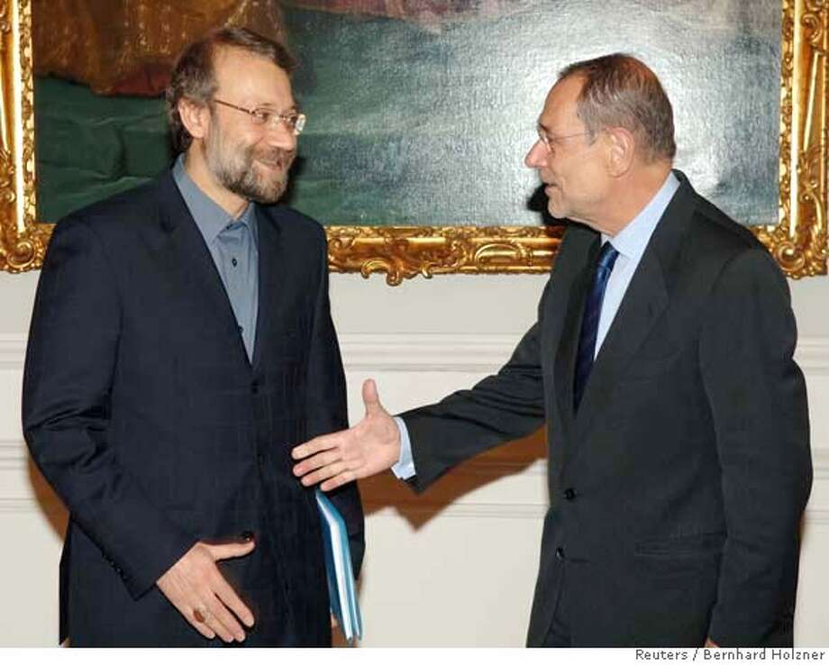 Iran's chief nuclear negotiator Ali Larijani (L) meets European Union foreign policy chief Javier Solana in the Austrian Chancellor Wolfgang Schuessel's office in Vienna September 9, 2006. Iran's top nuclear negotiator and the EU foreign policy chief met on Saturday in what may be a last chance to avert U.N. Security Council moves to hit Tehran with sanctions over its atomic ambitions. REUTERS/HO/Bernhard Holzner 0 Photo: HO