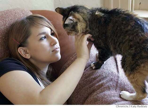 "911KIDS_004_RAD.jpg  SHOWN: Elina Ansary, age 15, with her cat ""Autumn"" at her home in San Francisco. Elina attends SF's School of the Arts. Story is about kids who have come of age since 9/11 how the WTC bombings have shaped their world view: changed their lives, what fears they have, who is brave, etc. Photos shot on Monday, July 31, 2006, in San Francisco, CA. Photo taken on 7/31/06, in San Francisco, CA.  (Katy Raddatz/The S.F.Chronicle)  **John Marsh Davis Mandatory credit for photographer and the San Francisco Chronicle/ -Mags out Photo: Katy Raddatz"