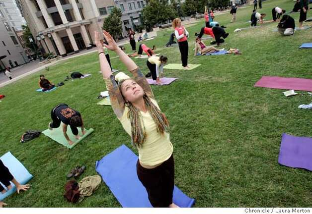 Alissa Weisman participates in Yoga for Peace outside the Oakland City Hall on Saturday, Sept. 9, 2006 in Oakland, CA. Participants in the event, which started in New York City as a response to 9/11, did 108 sun salutations. The Oakland event was one of several Yoga for Peace gatherings held around the world on Saturday. *** Alissa Weisman MANDATORY CREDIT FOR PHOTOGRAPHER AND SAN FRANCISCO CHRONICLE/ -MAGS OUT Photo: Laura Morton