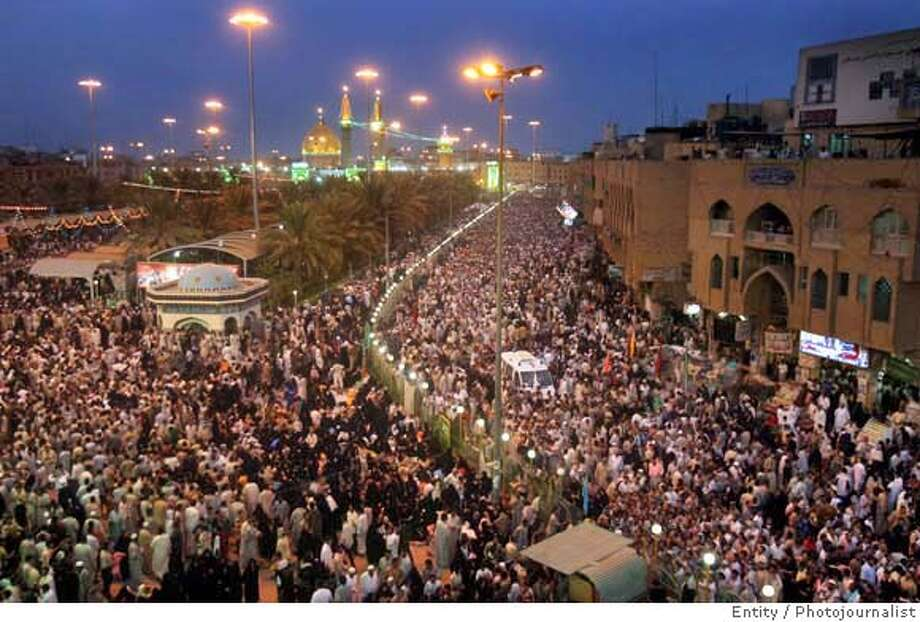 Thousands of Shiite pilgrims throng on the streets to mark the anniversary of the birth of Shiite Imam Al-Mehdi al-Muntadhar in Karbala, 110 kilometers (68 miles) south of Baghdad, Iraq, Friday Sept. 8, 2006. Officials said they expected as many as 3 million pilgrims at the religious festival in the holy city of Karbala to mark the 15th day of Shaaban on Sept. 9, 2006, the birthday of the, 9th-century religious Shiite saint. (AP Photo/Hadi Mizban) Photo: HADI MIZBAN