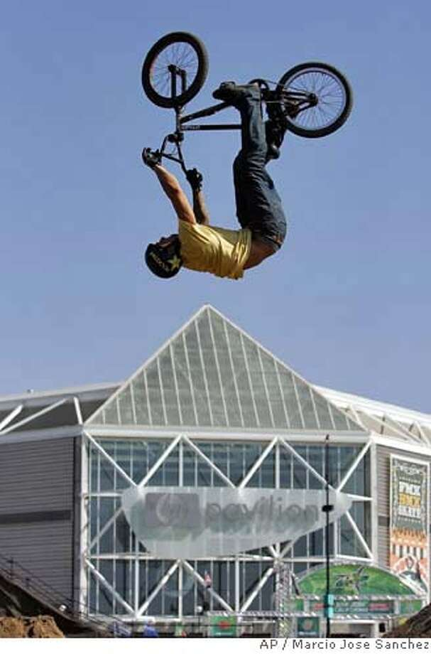 Luke Parsow, of Riverside, Calif., performs a trick during a preliminary heat of the BMX Dirt Bike competition of the Dew Action Sports Tour in San Jose, Calif. on Thursday, Sept. 7, 2006. The event, which includes BMX, motocross and skate boarding competitions, runs through Sunday, Sept. 10, 2006. (AP Photo/Marcio Jose Sanchez) STAND ALONE PHOTO EFE OUT EFE OUT Photo: MARCIO JOSE SANCHEZ