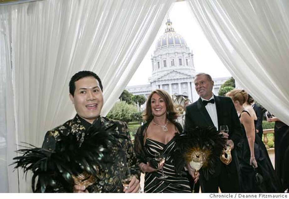 opera_0101_df.jpg  Arriving for the party before the Opera are: at left, fashion designer Max Nugus who designed the outfits and masks for himself and his friends, Mary and George Sanbrook. Opening of the San Francisco Opera season. Photographed in San Francisco on 9/8/06.  (Deanne Fitzmaurice/ The Chronicle) Photo: Deanne Fitzmaurice