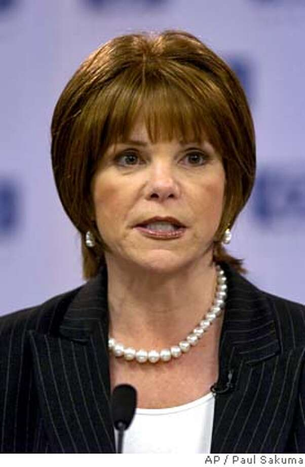 Hewlett-Packard Company's Patricia Dunn speaks during a news conference about new HP new CEO Mark Hurd at HP headquarters in Palo Alto, Calif., Wednesday, March 30, 2005. Dunn, one of the most powerful women in corporate America and the chairwoman of the 11th largest company on the Fortune 500. She oversaw the ouster of former HP CEO Carly Fiorina in February 2005 and the hiring of Mark Hurd as her successor. Now she may be the next one to leave the Palo Alto, Calif.-based company after overseeing an unusually invasive and legally questionable investigation into a media leak among the computer maker's board of directors. (AP Photo/Paul Sakuma) Photo: PAUL SAKUMA