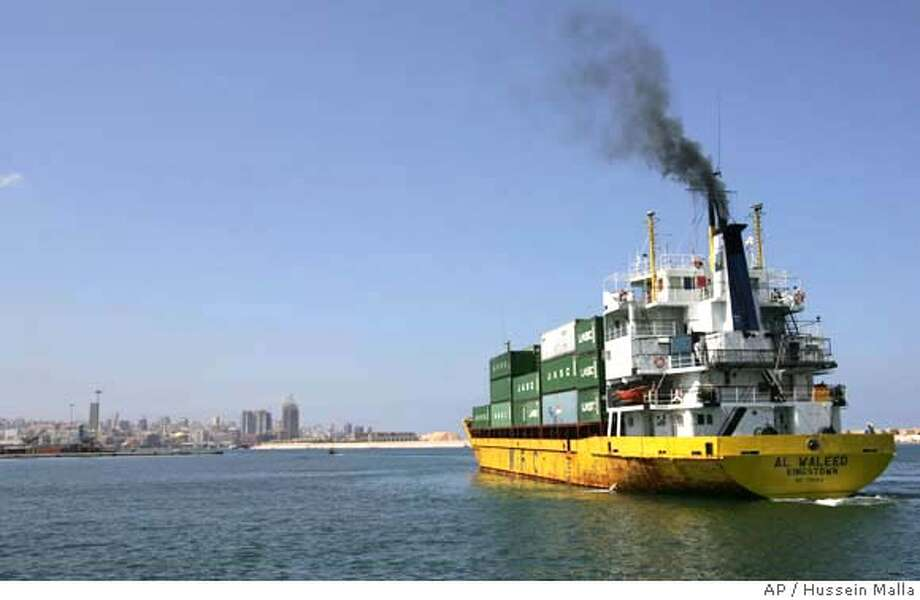 The Lebanese cargo ship 'Al Waleed Kingstown' arrives at the Beirut seaport, Lebanon, Friday, Sept. 8, 2006, before the announcement of the end of the Israeli naval blockade. Company officials said they did not seek Israeli permission to come to the port. Israel lifted its nearly 2-month-old naval blockade of Lebanon on Friday after European warships began patrolling off the coast to prevent the entry of weapons for Hezbollah guerrillas, the head of the U.N. peacekeeping force in Lebanon said. (AP Photo/Hussein Malla) Photo: HUSSEIN MALLA
