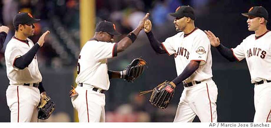 San Francisco Giants', from left, Pedro Feliz, Ray Durham, Randy Winn and Todd Linden celebrate a 4-0 win over the San Diego Padres in a baseball game on Friday, Sept. 8, 2006, in San Francisco. (AP Photo/Marcio Jose Sanchez) Photo: MARCIO JOSE SANCHEZ