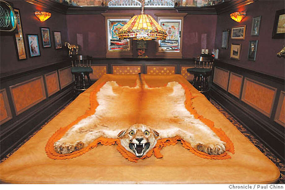 An antique mountain lion rug in the basement is the fiercest-looking creature in the Carvalho zoo of taxidermy. Its usual spot is on the wall, where it won't frighten off would-be billiard players. Chronicle photo by Paul Chinn